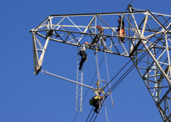 Men at work for the maintenance of a power line